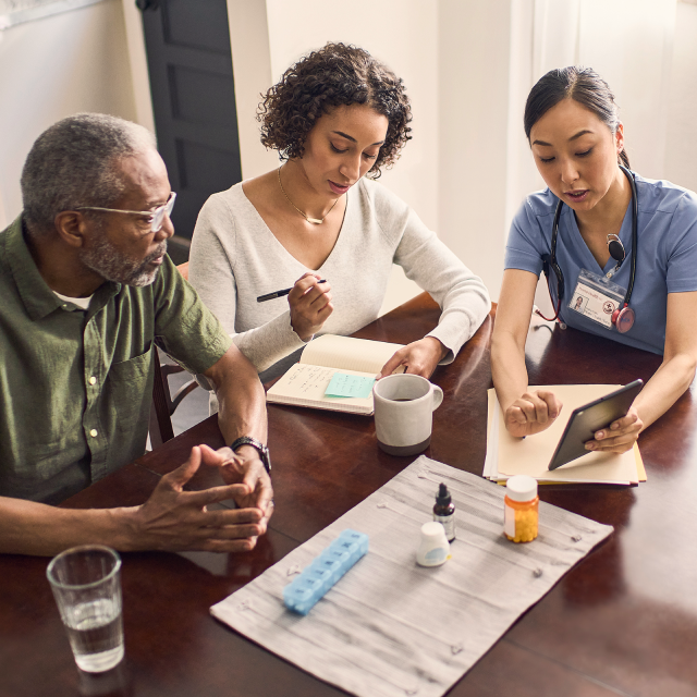 Healthcare workers discussing home-centered care with patient