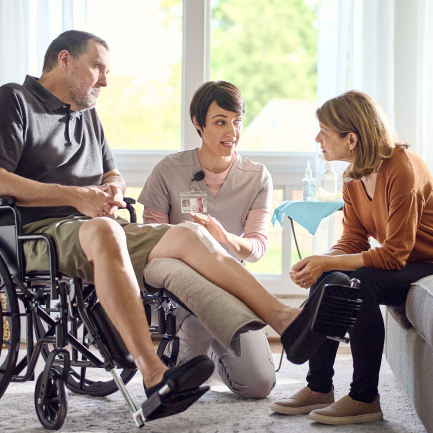 Healthcare worker talking to home centered care patient