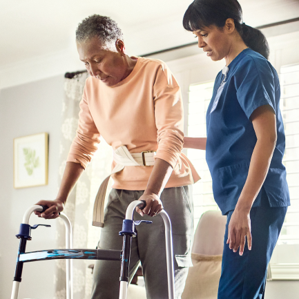 Healthcare helping patient in home with acute condition