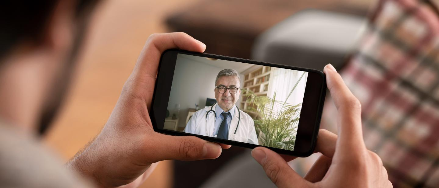 Patient uses phone to speak with physician via video chat