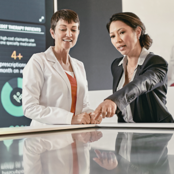 Two woman data analysts pointing at data types
